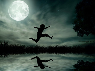 Teenager jumping in water over lake, moonlight moon background