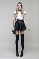 Beautiful woman is in fashion style in black mini skirt