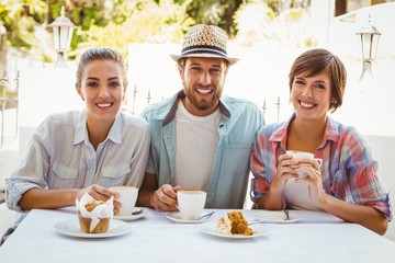Happy friends enjoying coffee together