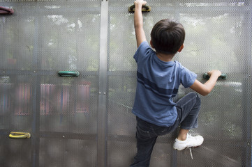 child climbing on a wall