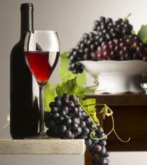 red wineglass with grapes