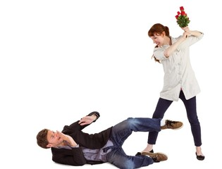 Woman throwing roses at man