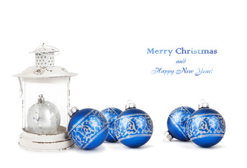 Blue and silver Christmas balls and vintage lantern isolated on