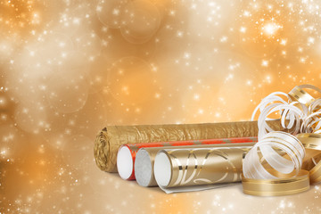 Rolls of multicolored wrapping paper for gifts with a streamer o