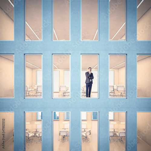 Leinwandbild Motiv Business man looking through window