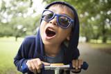 Boy riding a bike with shouting