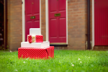 Christmas presents delivered to house front door in summer