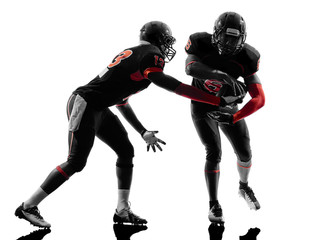 two american football players passing play action silhouette