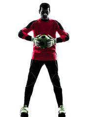 caucasian soccer player goalkeeper man  holding ball silhouette