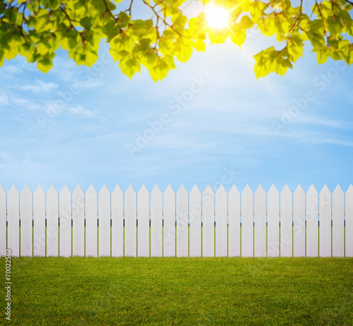 Fotobehang Tuin White wooden fence in the back yard with copy space