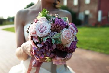 Bride showing bouquet