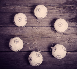 white Christmas balls on old wooden background