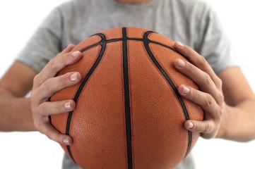 Basketball ball in hands.