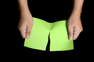 Hand Tearing Green Paper