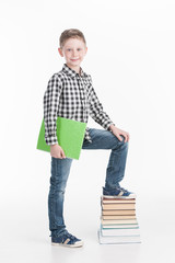 Happy schoolboy with books isolated on white background.