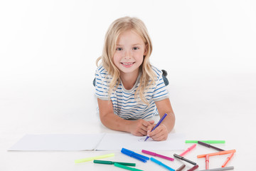 happy pretty girl drawing with pencils.