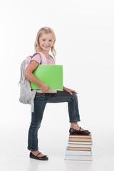 portrait of school girl holding books.