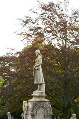 Lady statue on grave