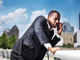 african businessman talking on smartphone