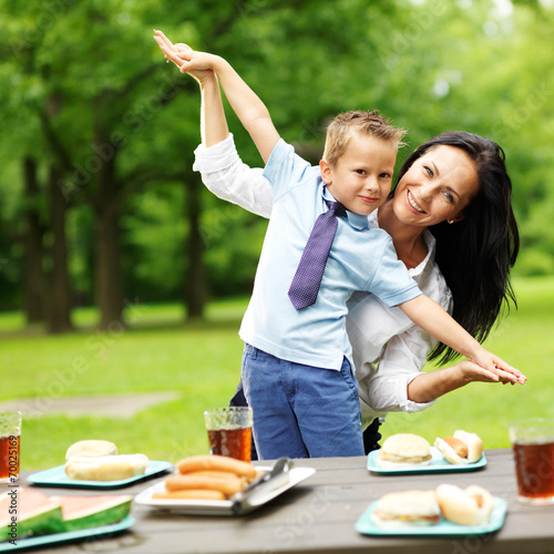 mother and son at picnic in park - 70025169