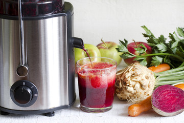 Juicer and juice with fresh fruits and vegetables
