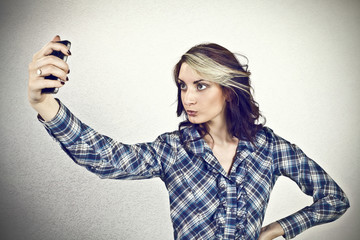 Girl taking self photo with smart phone