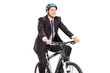 Young businessman riding a bicycle