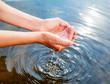 Leinwanddruck Bild - Holding water in cupped hands