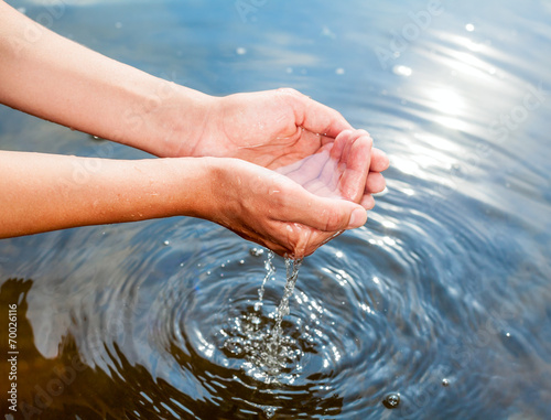 canvas print picture Holding water in cupped hands
