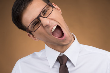 young business man or student screaming.