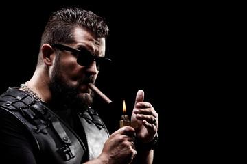 Badass biker lighting up a cigarette