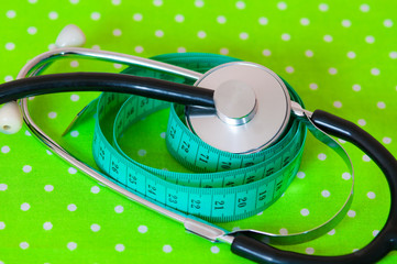 measuring tape and stethoscope