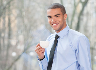 Close up portrait of happy businessman drinking coffee.