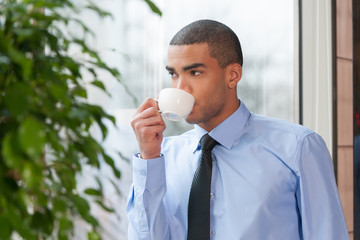 Close up portrait of businessman drinking coffee.