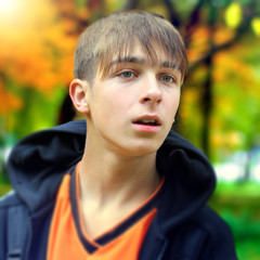 Teenager in the Autumn Park