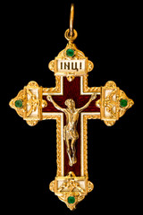 Christian yellow golden cross with emeralds on black