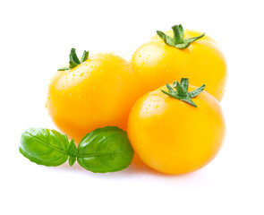 Yellow tomatoes with basil.