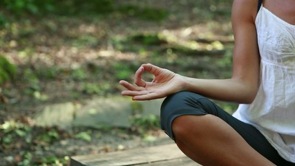 Woman practicing yoga moves in the forest
