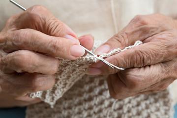 older woman crocheting