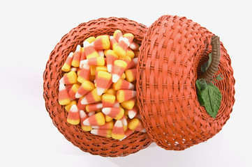 Candy Corn In Pumpkin Basket Isolated