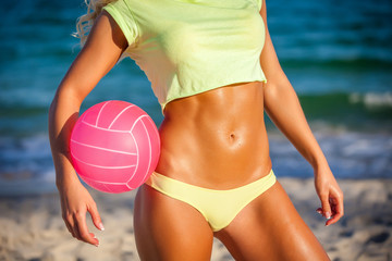 young beautiful girl outdoor in volleyball game