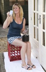 Woman drinking tea taking a break from painting
