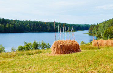 Straw haystack on the background of the river