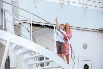 Happy mother with son travel on cruise ship