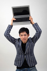 Crazy Business man with worn-out laptop