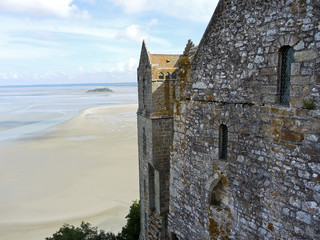 tidal bay and wall of mont saint-michel abbey