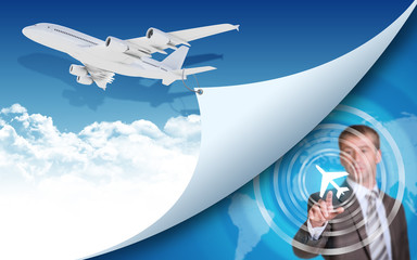 Airplane and businessman finger presses virtual airplane