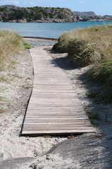 Wooden flooring leading to the beach