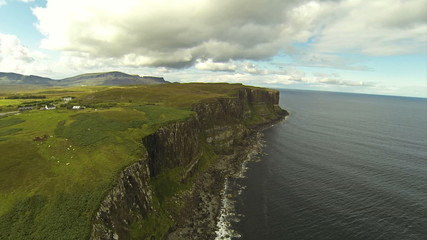 Camera flying over cliffs on the Isle of Skye in Scotland.