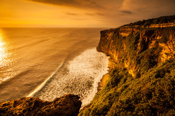 view of sunset at cliff in Bali Indonesia.